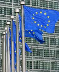 European Union flags are seen outside the European Commission headquarters during the EU summit in Brussels